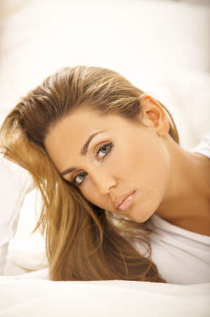 Portrait of Fresh and Beautiful brunette woman on bed Stock Photo - 749690