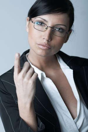 morena sexy: Mujer de negocios hermosa y atractiva del brunette aislada en fondo claro Foto de archivo