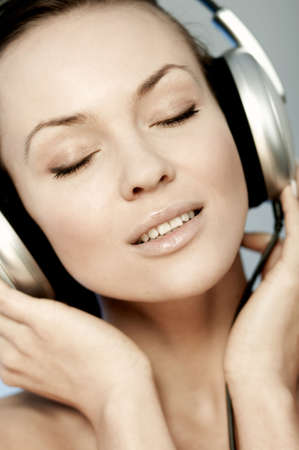 Portrait of Fresh and Beautiful sexy young woman with headphones photo