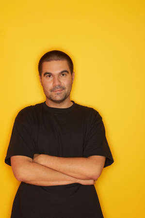25-30 years old handsome caucasian man posing at yellow background, smiling Stock Photo - 1092560