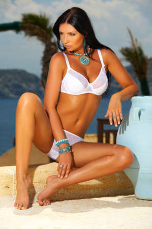 Beautiful young Sexy model posing in lingerie at seaside outdoors Stock Photo