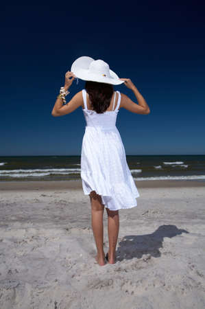 20-25 years old Beautiful Woman on the beach, wearing hat Stock Photo