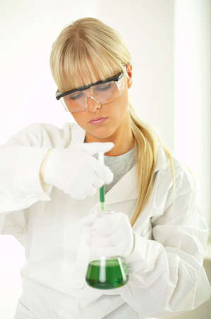 Female lab worker testing and experimenting photo