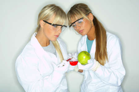 observe: Beautiful female lab workers testing and experimenting Stock Photo