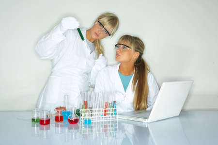 Beautiful female lab workers testing and experimenting photo