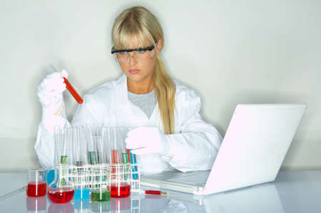 experimenting: Beautifula female lab worker testing and experimenting