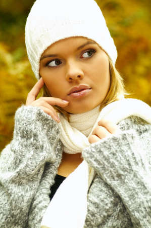 20-25 years old beautiful sexy woman portrait in autumn outdoors photo