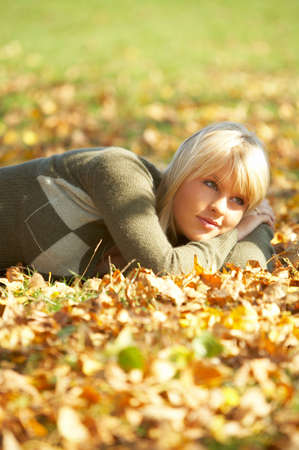 20-25 years old beautiful sexy woman portrait in natural autumn outdoors photo