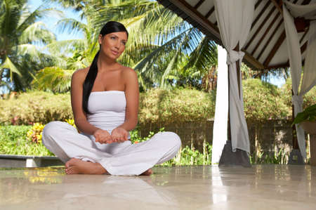 surrounding: 20-25 years woman portrait during yoga at exotic surrounding, bali indonesia