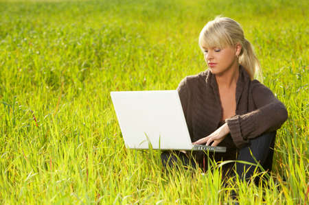 leasure: 20-25 years old beautiful sexy woman portrait working on laptop computer in natural autumn outdoors