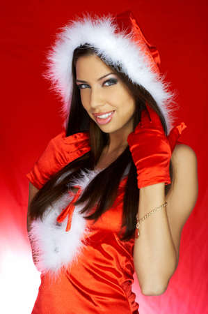 Portrait of beautiful brunette woman wearing sexy santa claus clothes on red background Stock Photo - 2146675