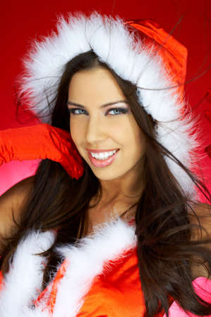Portrait of beautiful brunette woman wearing sexy santa claus clothes on red background Stock Photo - 2146689
