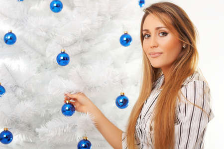 Beautiful young woman next to christmas tree Stock Photo - 2214983