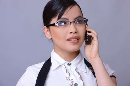 businesswear: Beautiful brunette business woman with glasses isolated on clear background
