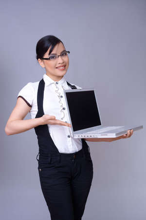 Beautiful brunette business woman with laptop computer photo