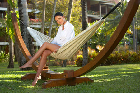 Woman relaxing on hammock at exotic surrounding at bali indonesia Stock Photo - 2459978