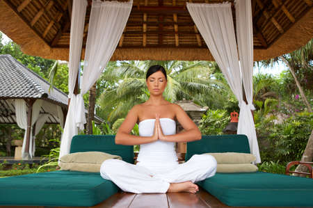 indonesia girl: 20-25 years woman portrait during yoga at exotic surrounding, bali indonesia