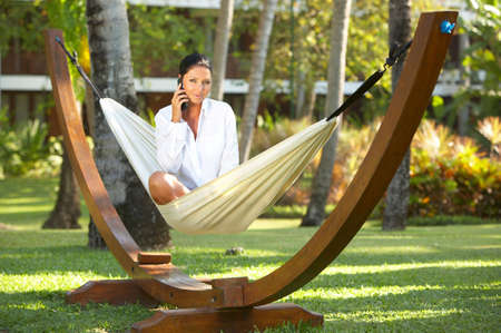 surrounding: 20-25 years woman portrait ralaxing on hammock at exotic surrounding, bali indonesia Stock Photo