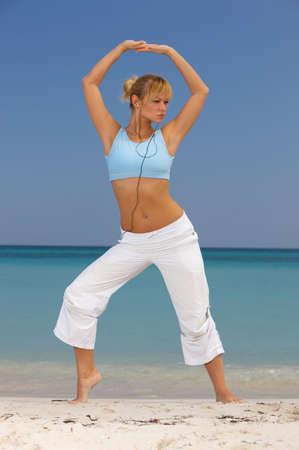 cuba girl: Young beautiful woman during fitness on sea beach