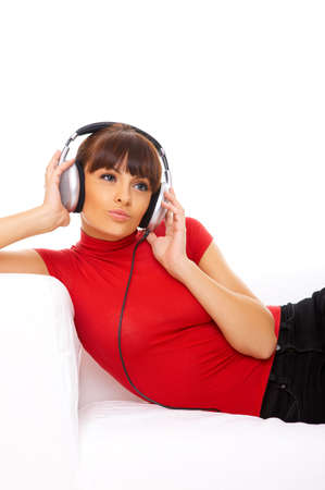 sexy headphones: Beautiful girl is listen to the music Stock Photo