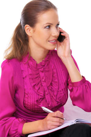 Beautiful business woman is using mobile telephone photo