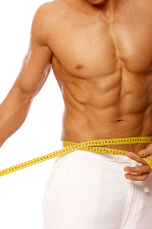 arms body: Muscular and tanned male body parts is being measured Stock Photo
