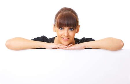 Beautiful business woman holding empty white board Stock Photo - 3344427