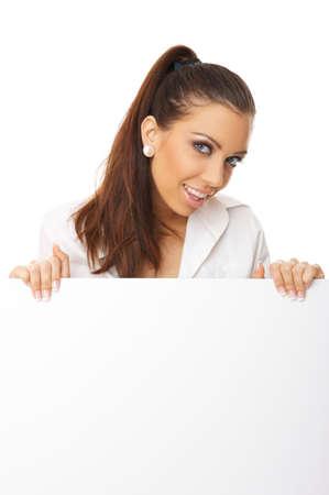 Beautiful business woman holding empty white board Stock Photo - 3344431