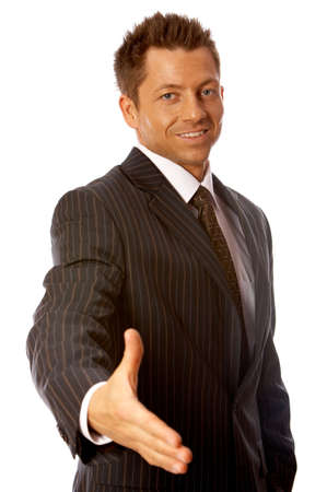 Handsome Businessman with welcome hand gesture Stock Photo - 3418141