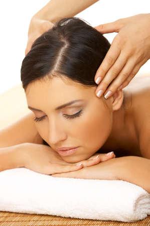 Portrait of Fresh and Beautiful brunette woman taking head massage Stock Photo