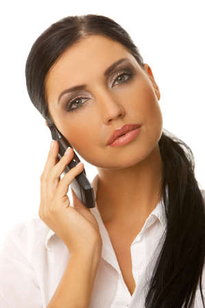Beautiful business woman is using mobile telephone Stock Photo - 3508544