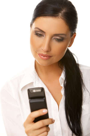 Beautiful business woman is using mobile telephone Stock Photo - 3508540