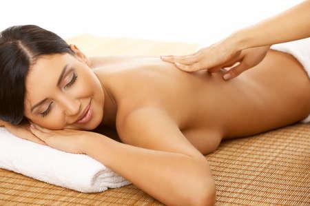 Portrait of Fresh and Beautiful brunette woman taking massage Stock Photo