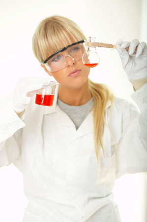 Beautiful female lab worker testing and experimenting photo