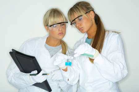 Female lab workers testing and experimenting photo