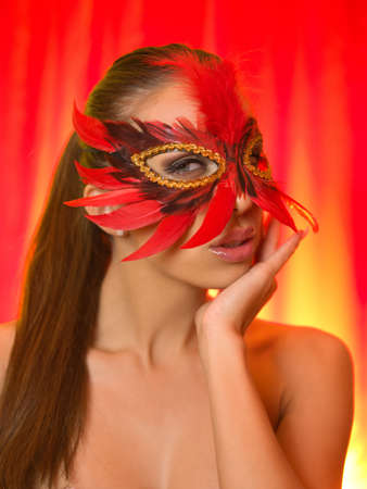 Portrait of attractive beautiful young woman wearing red carnival mask Stock Photo - 3557227