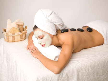 Portrait of beautiful woman during spa treatment photo