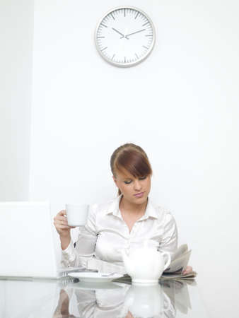 Business woman is working and drinking cofee photo