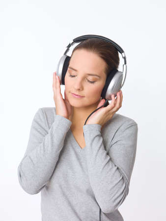 Portrait of beautiful young woman with headphones  photo