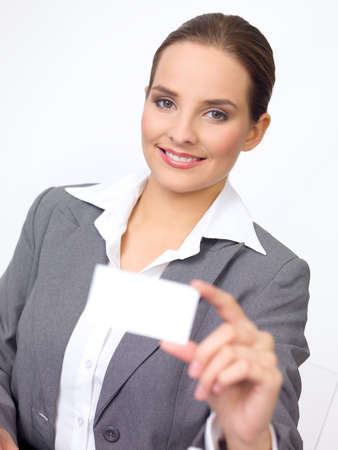 Portrait of beautiful and young business woman holding empty card photo