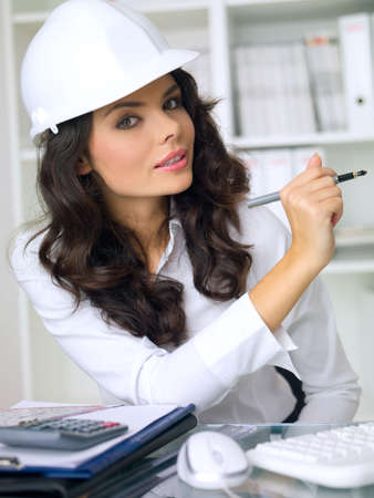 Beautiful female architect is working in her office photo