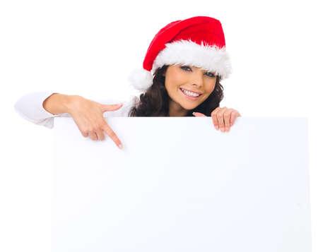 Beautiful christmas woman in santa hat holding empty board Stock Photo