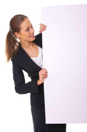 Beautiful business woman holding empty white board Stock Photo - 3794023