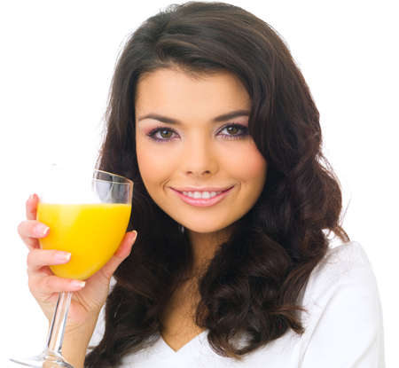 Portrait of beautiful business woman holding glass with juice photo