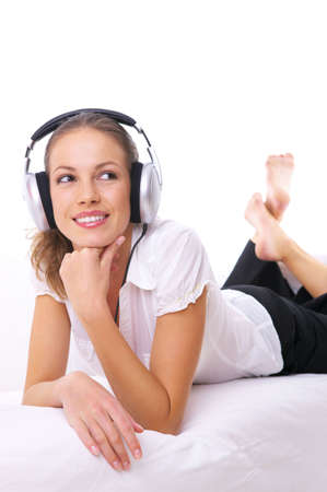 Beautiful girl is listen to the music on couch photo