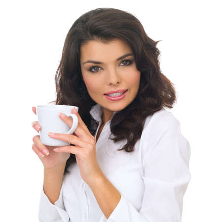 women holding cup: Portrait of beautiful business woman holding coffee cup