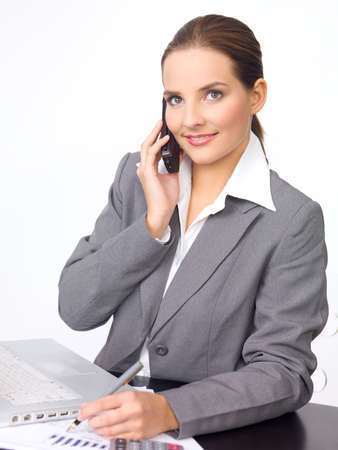 Portrait of beautiful and young business woman working on laptop photo