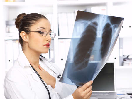 Portrait of female doctor examining x-ray picture Stock Photo - 3898811