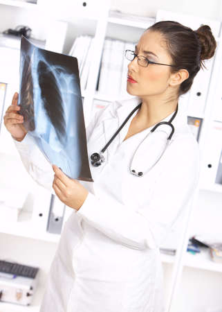 Portrait of female doctor examining x-ray picture Stock Photo - 3898813