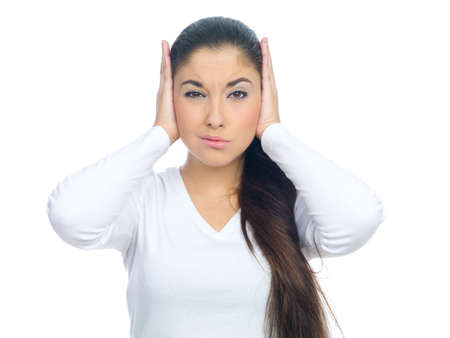 nice looking: Portrait of a nice looking woman covers her ears Stock Photo